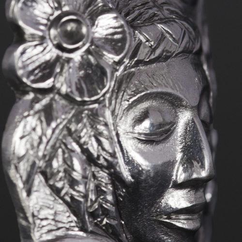 human with flowers earrings woman Gus Cook Kwakwaka'wakw silver Repoussé jewelry pendant native art northwest coast 1 3/4 x 1 3/4 2000 Mother Earth