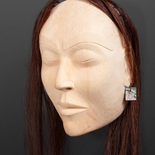 "Woman Portrait Mask Raymond SHaw Kwakwaka'wakw Yellow cedar, horse hair, abalone 11"" x10"" x 5"" 31"" with hair $3000"
