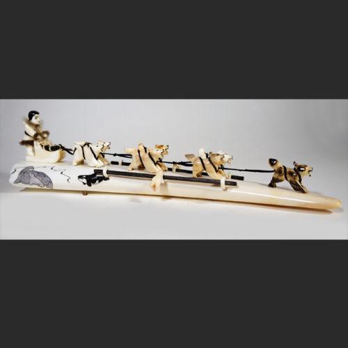"Dog Sled Team Mary Seppilu Yupik fossil walrus ivory, baleen, india ink, seal fur 14""L X 3 ½""W X 3 ½""H Sold"