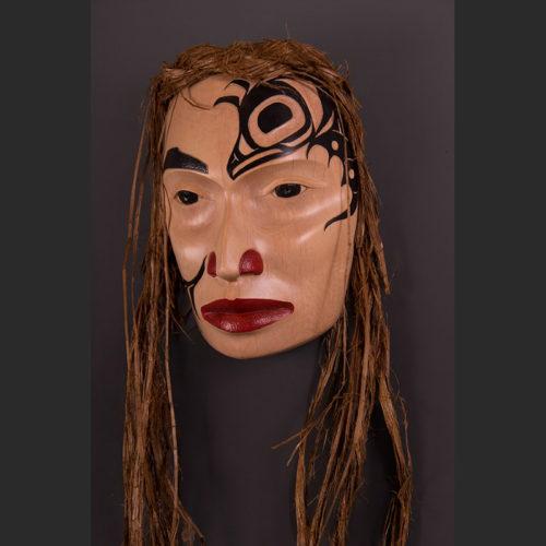 "Maiden of Temlahamid Portrait Mask Arlene Ness - Gitxsan Alder, paint, cedar bark 9"" x 6 3/4"" x 3 1/2"""