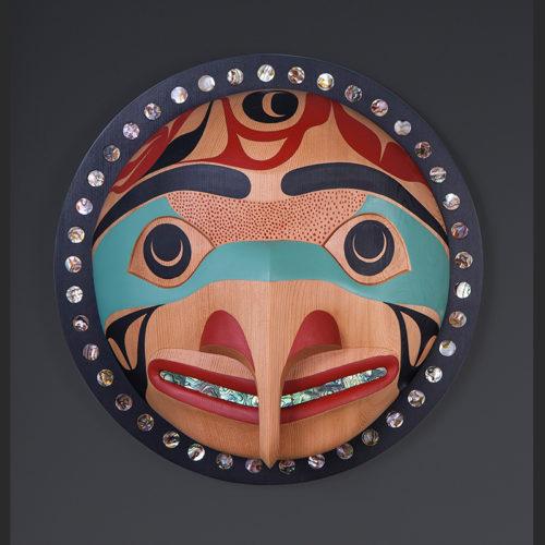"Eagle Moon Moy Sutherland Tla-o-qui-aht Red cedar, abalone, paint 15"" x 15"" x 5"""