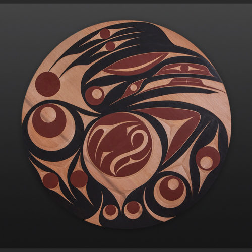"""raven and the star Andy Peterson Coast Salish raven star Red cedar, paint 35"""" dia. $3500"""
