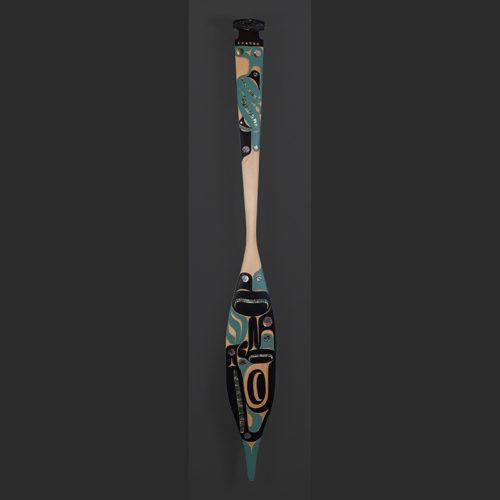 "Raven Paddle Moy Sutherland Tla-o-qui-aht $3500 Yellow cedar, abalone, paint 67"" x 7"""