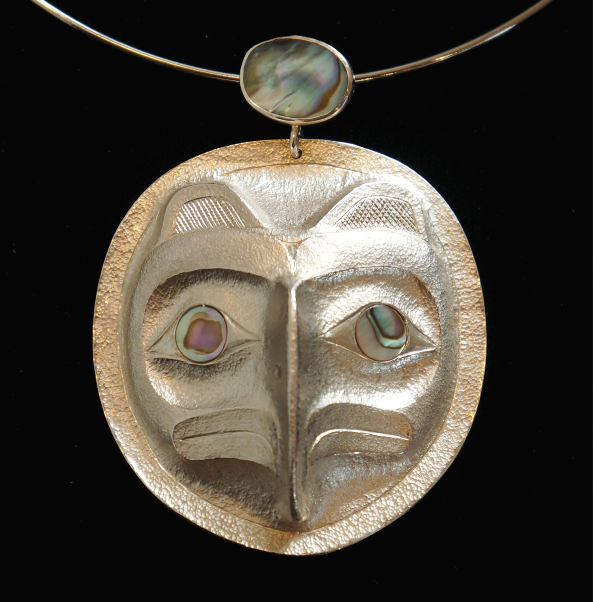 """Eagle Chief's Frontlet Pendant Rande Cook Kwakwaka'wakw repousse sterling silver, abalone 2.5""""H x 2.25""""W x .75""""D"""