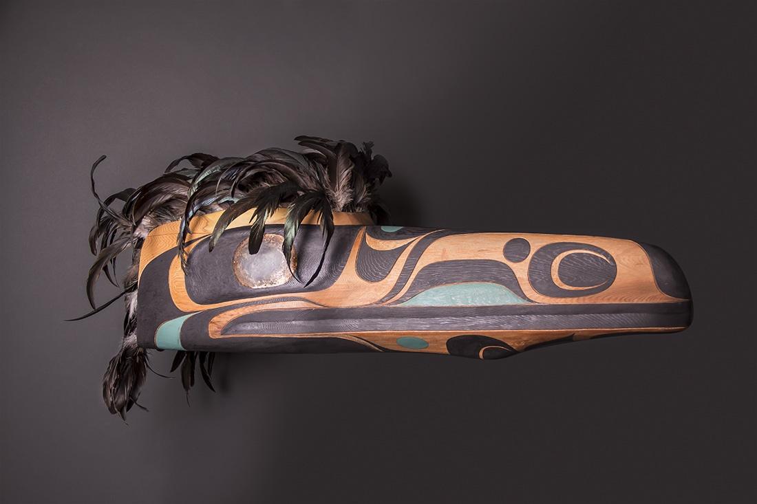 "Raven Headdress Rande Cook Kwakwaka'wakw red cedar, acrylic paint, copper, feathers 17""H x 35""L x 12""W"