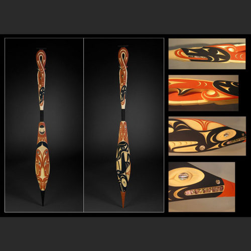 """killer whale, thunderbird, and double headed sea serpent paddle Luke Marston Coast Salish Yellow Cedar, Abalone, Acrylic Paint, Twine 64-1/2 x 6-1/4"""" sold """"I am inspired by the legacy of my ancestors. My work is the reflection of the respect I feel for the master carvers of long ago. I believe as an artist, that we have to find a balance between contemporary art, and at the same time evolve and grow as Coast Salish people."""""""