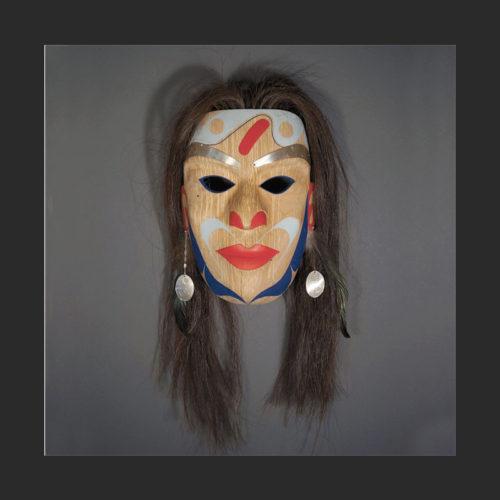 "Princess Mask Rande Cook Kwakwaka'wakw alder, acrylic paint, silver, horse hair, feathers 20""H x 10""w x 6""D"