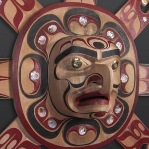 "Rising Sun Mask Raymond Shaw Kwakwaka'wakw Red cedar, abalone, brass, paint 64"" x 54"" x 11"" $12500"