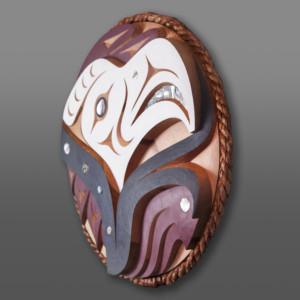 "Salish Eagle Luke & John Marston Coast Salish Red cedar, cedar rope, abalone, paint 22"" dia. x 3"" $6500"